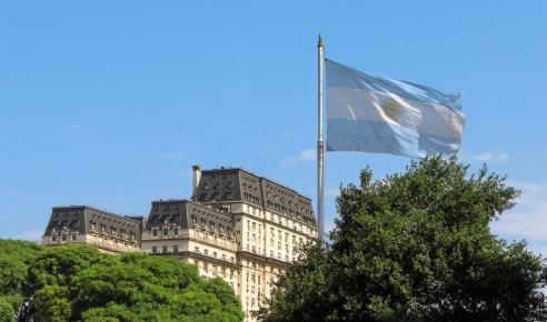 Argentine flag, antique building